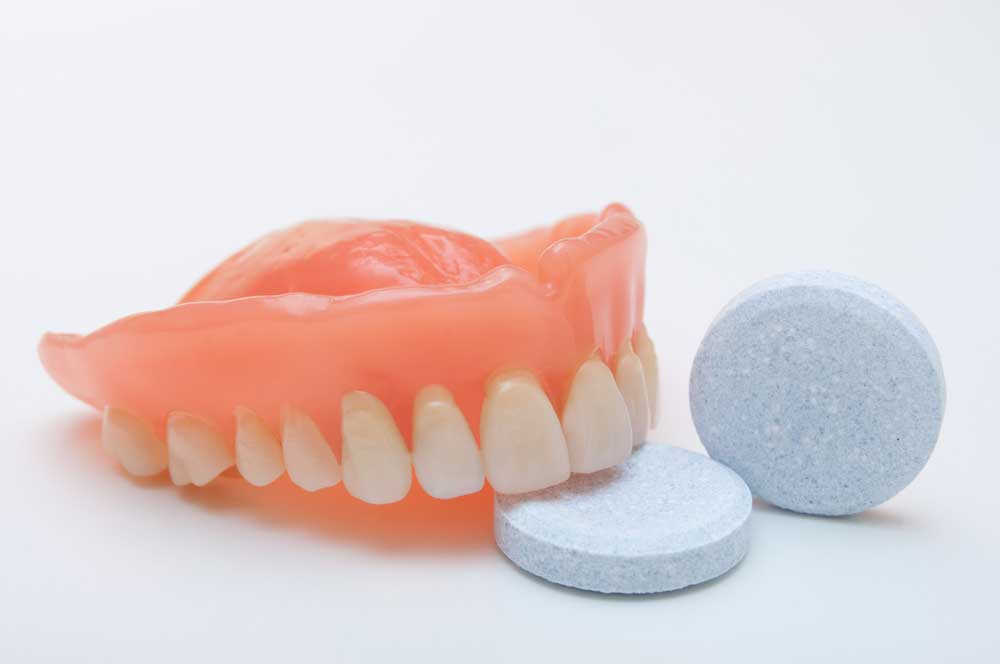 How are dentures repaired?